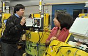 Bob Chen speaks with his colleagues as three sensor buoys are readied for the spring.