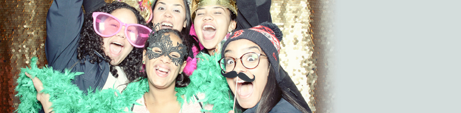 Prospective  UMass Boston students have fun in a photo booth.